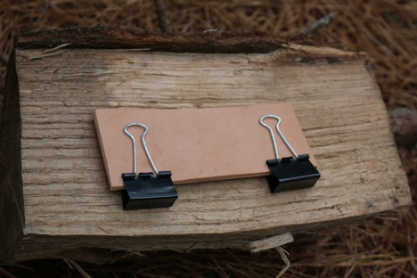 Holding leather in clips.