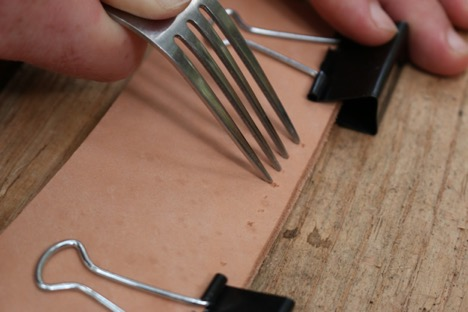 Spacing a leather with fork.