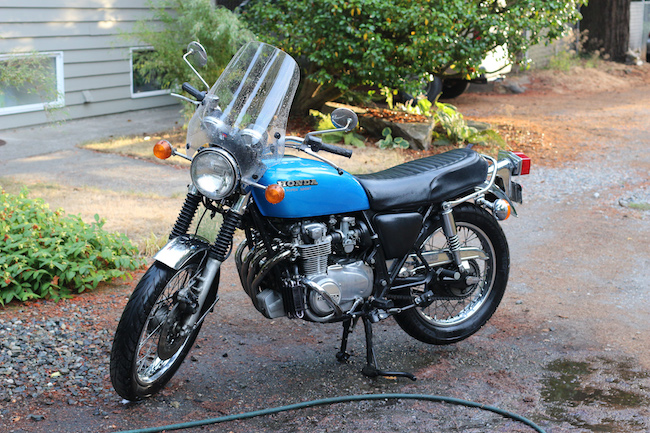 Blue honda motorbike after cleaning.