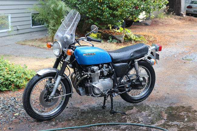 Blue Honda motorcycle displayed.