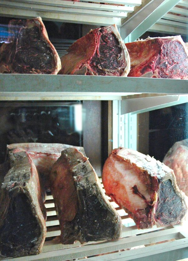 Dry-aged beef in drying chamber.
