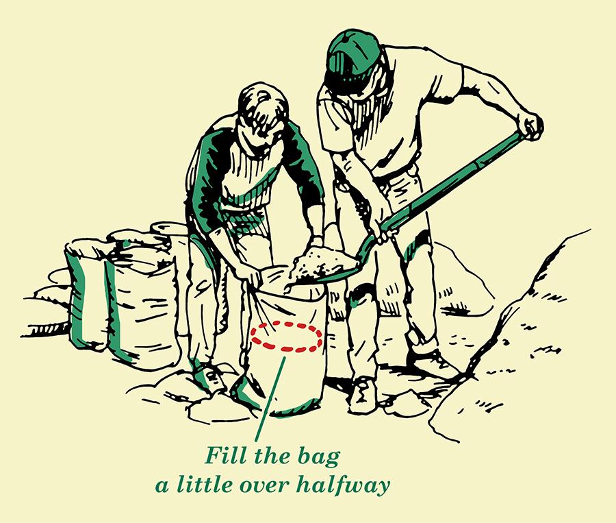 Labours filling sandbag with sand.