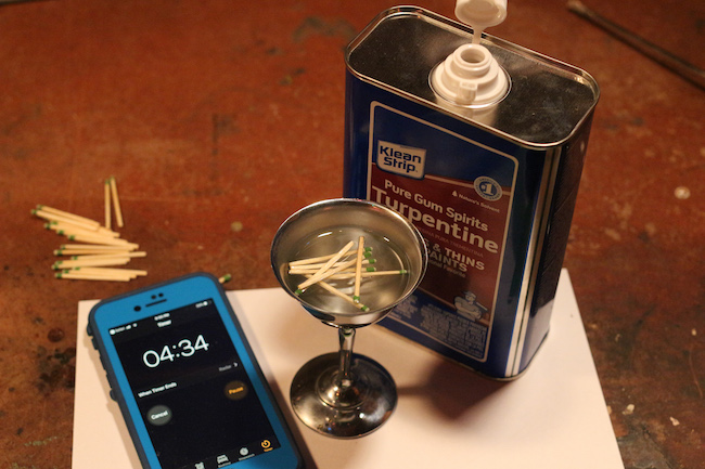 Matches poured in turpentine and a phone is placed with it.
