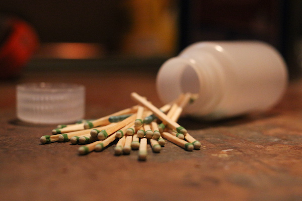 Matchsticks scattered out from a plastic bottle.