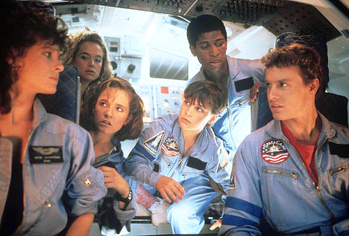"Scene from the movie ""Space Camp"" in which a group of astronauts are discussing in a spaceship."