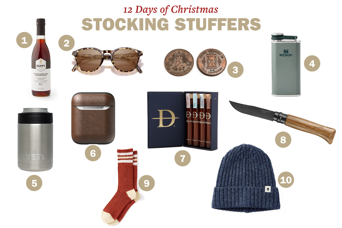 Stocking stuffers like syrup, glasses, coins, flask, colster, airpods case, knife, pair of socks, beanie and toothpicks are displayed.