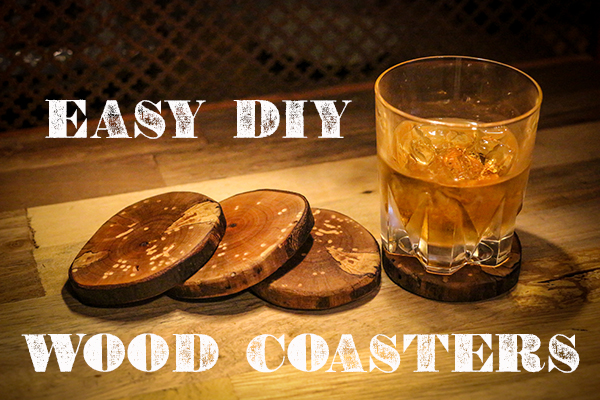 Wood coasters with a drink glass.
