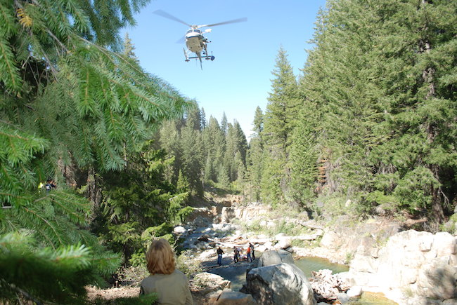 Rescue Team searching with helicopter.