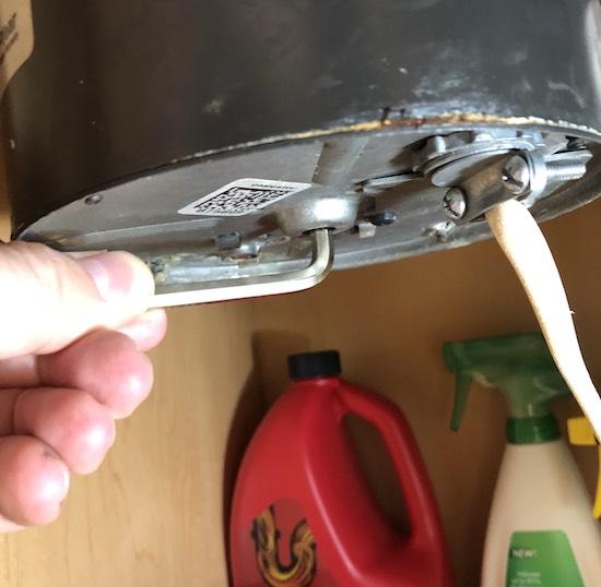Operating the manual crank.