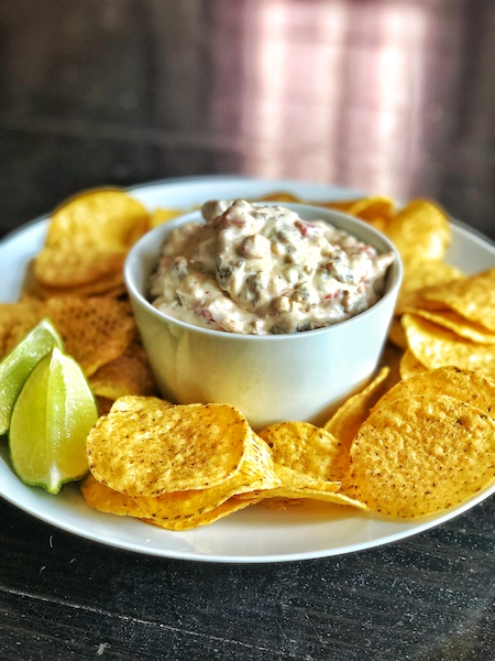 Loaded queso in a bowl.