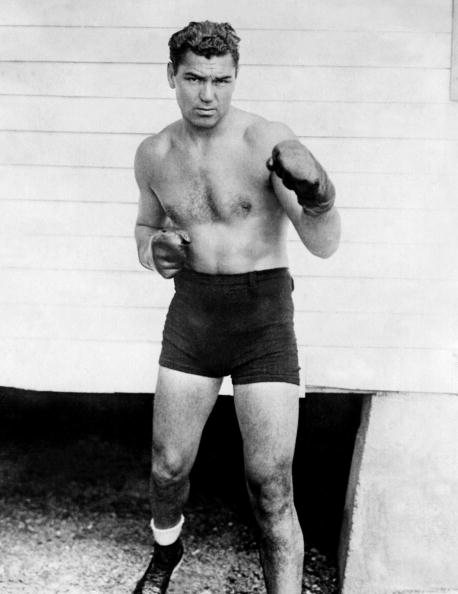 Jack Dempsey in black and white illustration with boxing gloves.