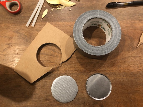 Cardboard circle with duct tape.