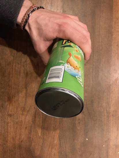 Man holding safe made with Pringles can.