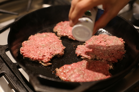 Salting a smashed beef.