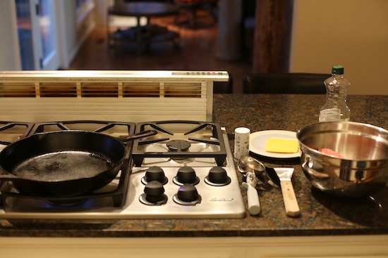 Fry pan on a stove and materials around it.