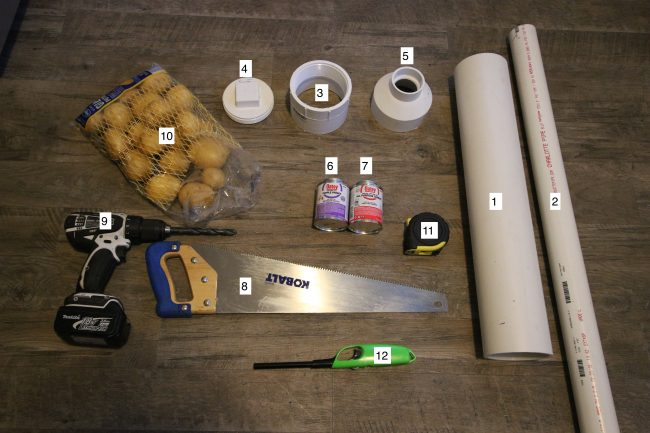 Two pvc pipes, threaded couplet, clean out cap, adapter, primer, cement, Saw , drill bit , potatoes, tape measure,stick lighter, hairspray displayed.