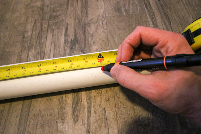 Measuring pipe with scale and pen.