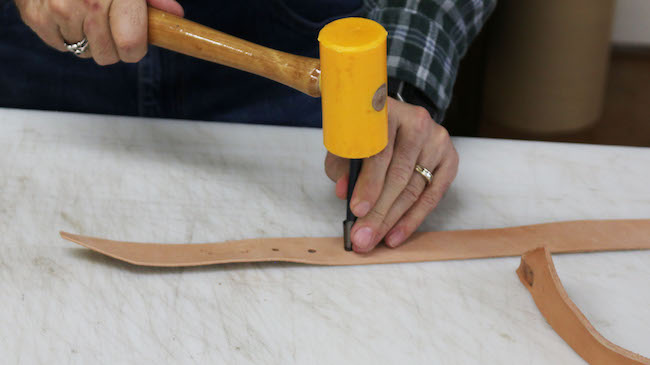 Rounding the hole using round drive punch.