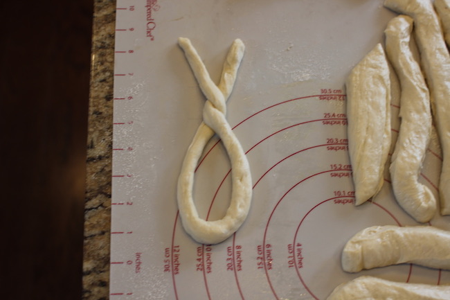 Dough transformed into round rope like structure.