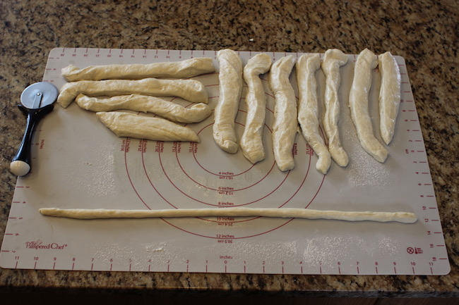 "Forming Dough ""Ropes"" Into pretzels."