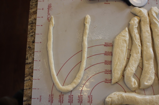 Dough transformed into large U-shape structure.