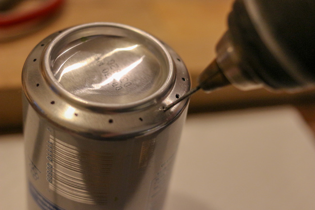Drilling holes in can.