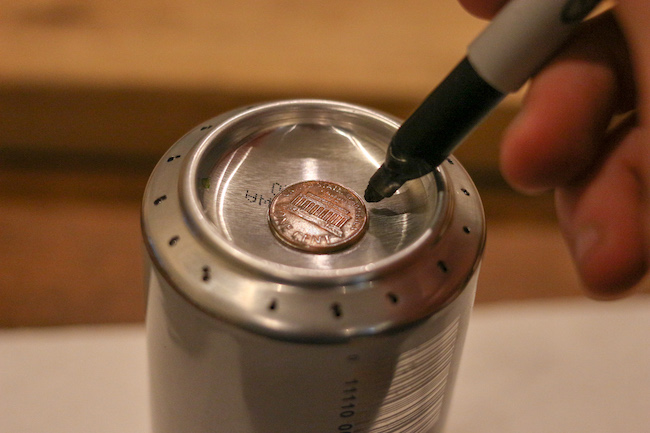 Marking penny on can.