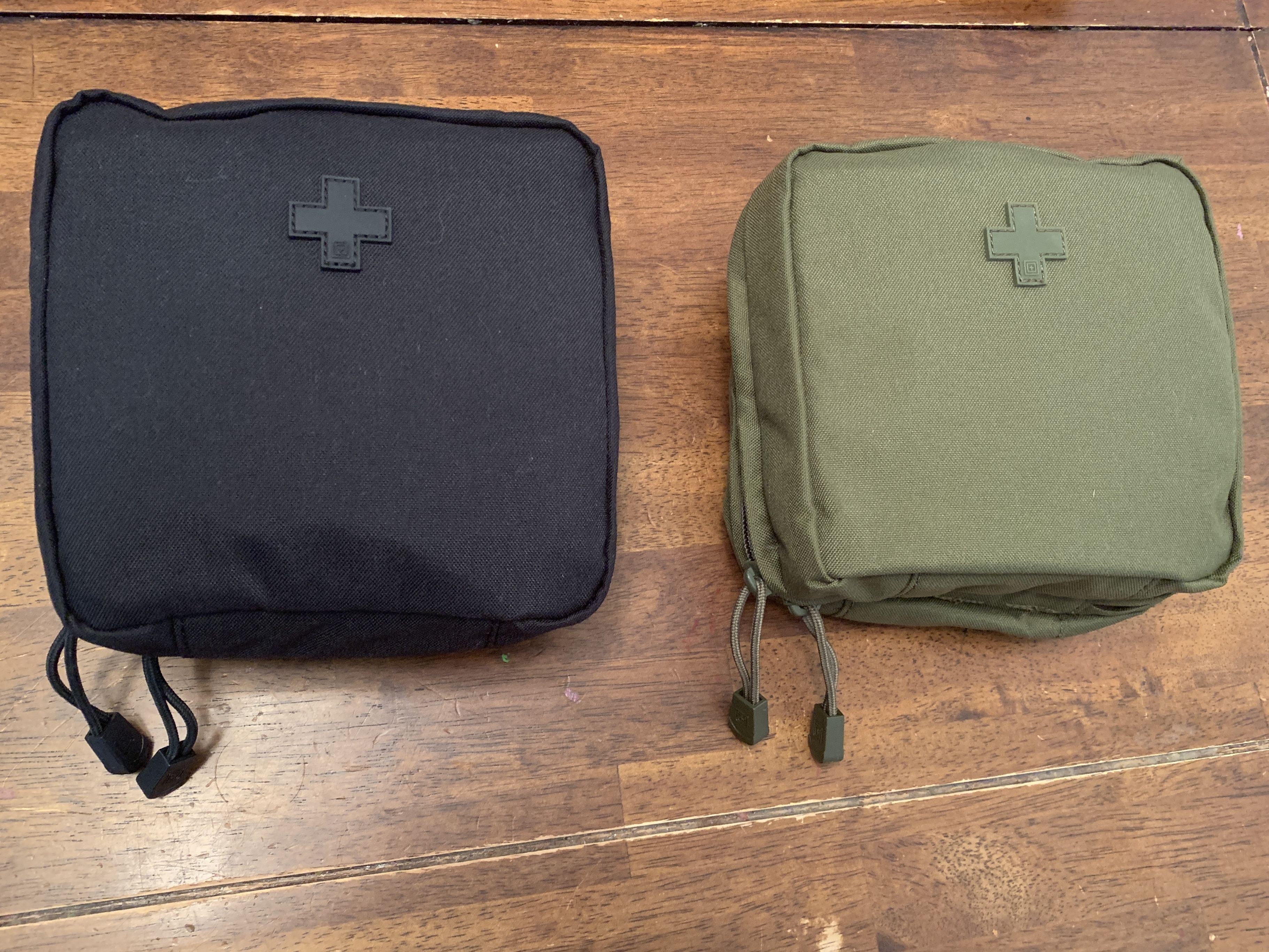 Pouches of first aid kit displayed.