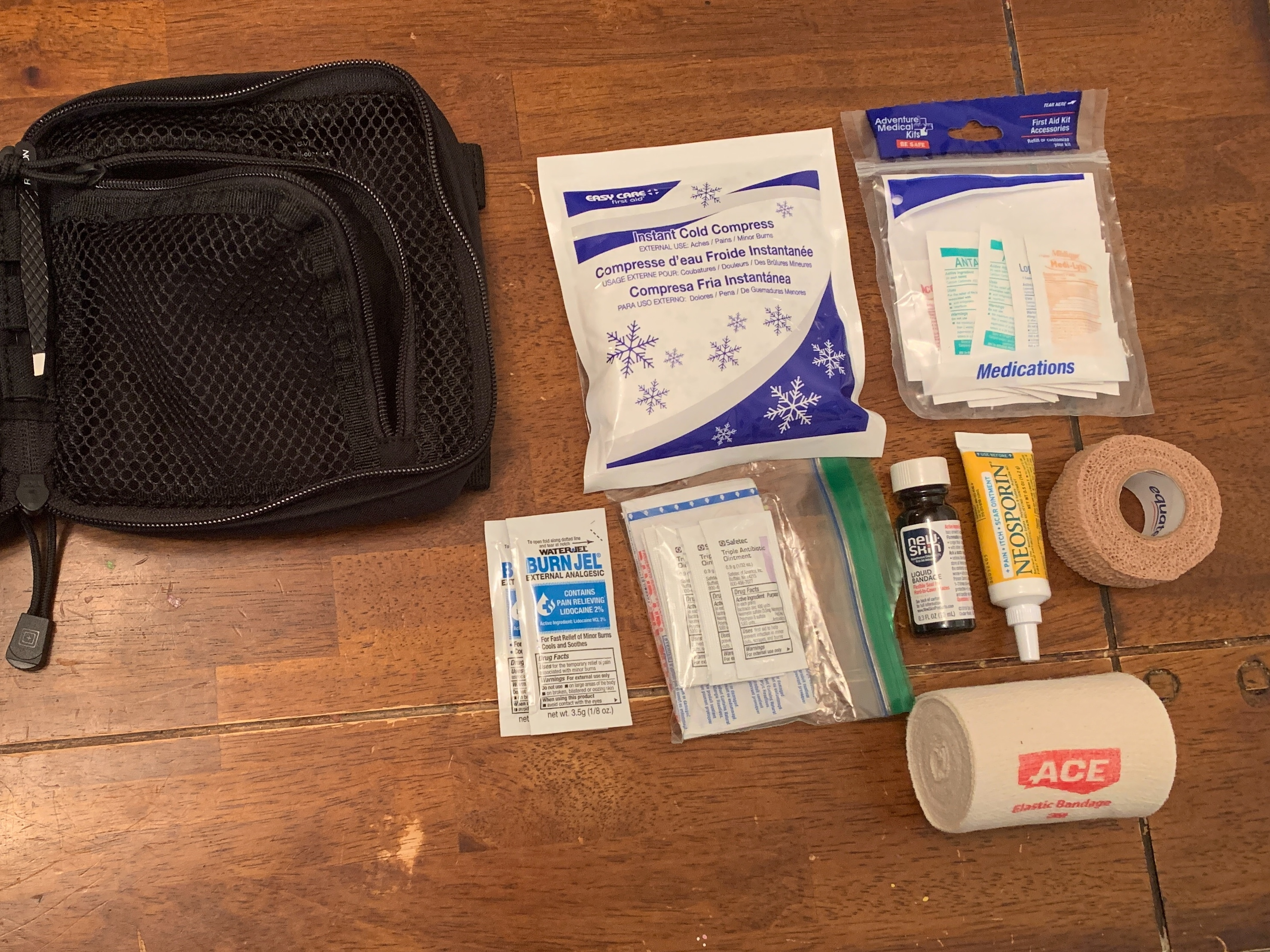 First aid kit tools displayed.