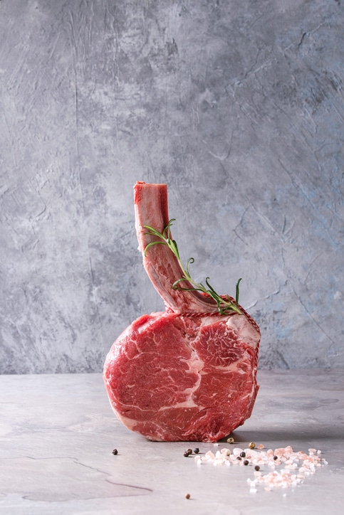 Tomahawk Steak placed vertically.