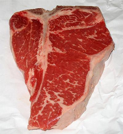 Thick t-bone uncooked steak.