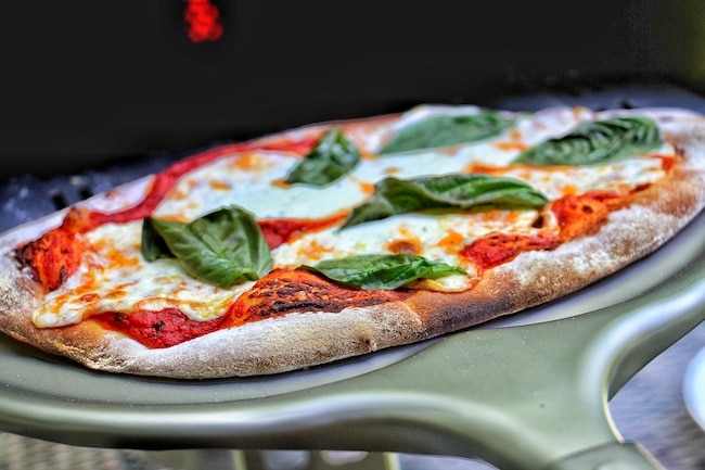 Pizza baked in oven.