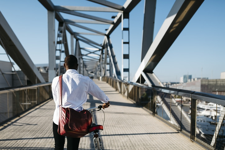 Man going to office on a bicycle.