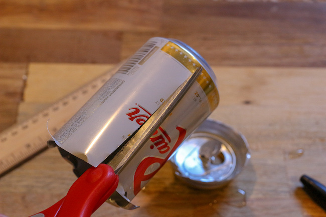 Cutting of a soda can from a top.