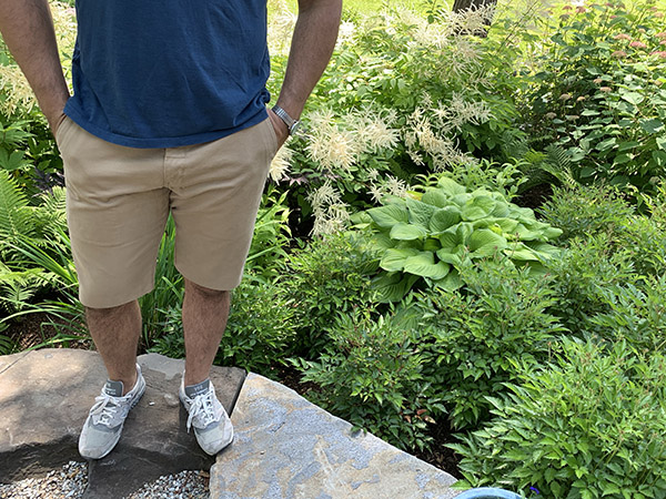 A man wearing shorts from pants.