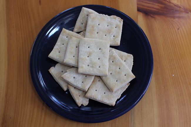 Half backed crackers in a plate.