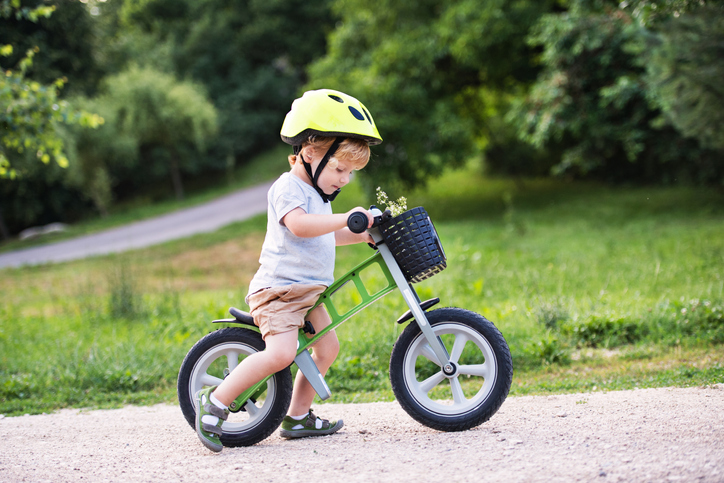 Kid trying to ride a bike.