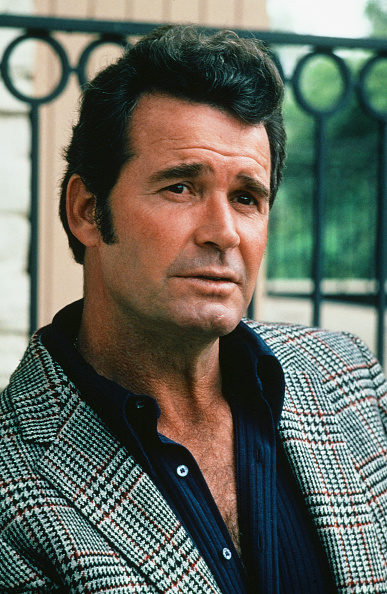 James Garner wearing glen check pattern coat.