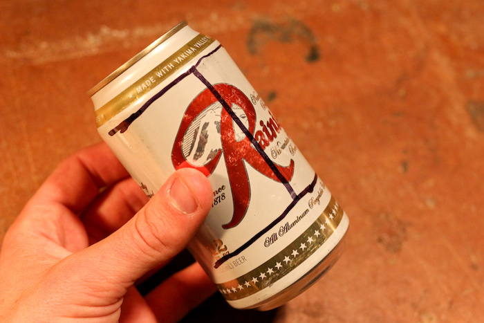 Step 1: Draw a big indication on can to cut it off.