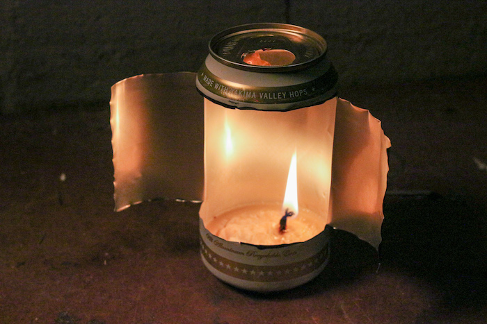 A lighten candle in the can.