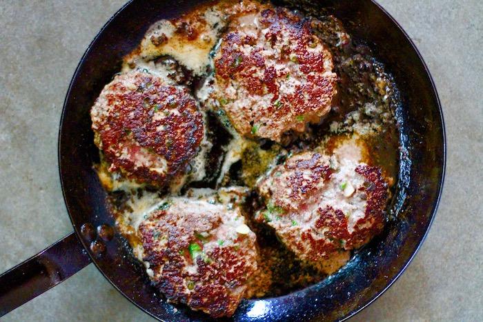 Fried patties in a pan.