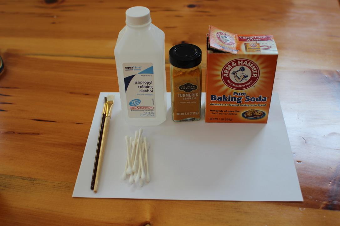Water & Baking Soda , Rubbing Alcohol & Turmeric with painting brush.