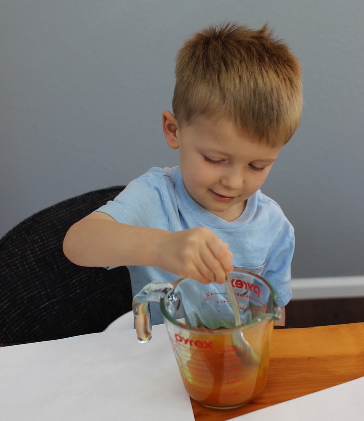 kid is Whipping up the reagent.