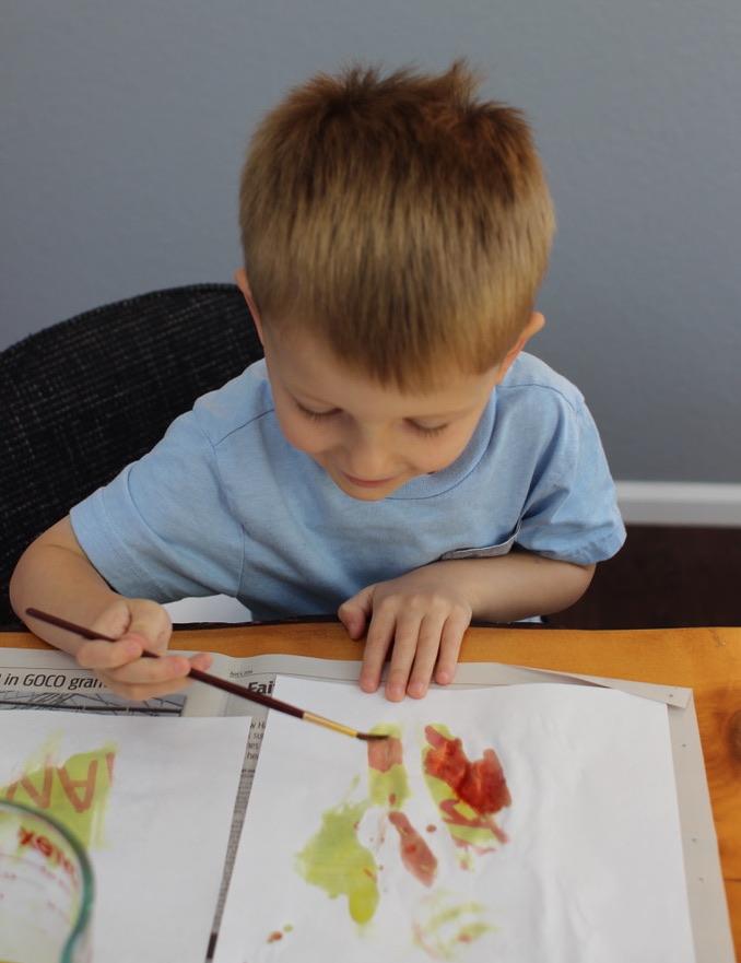 Kid is painting.