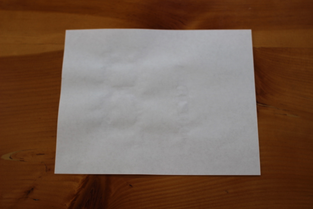 Outlines of a dried message on the paper.