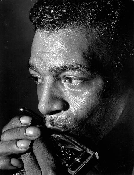 Vintage man playing Harmonica.