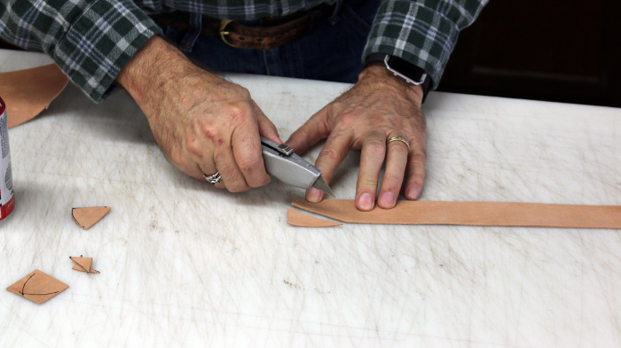 Cutting the leather by cutter.