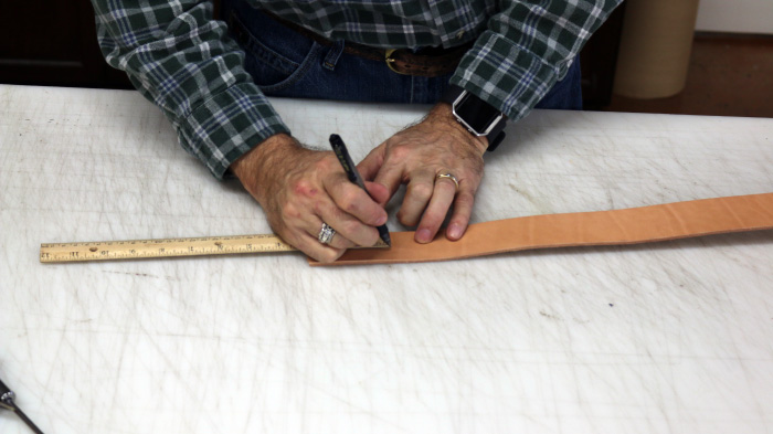 Marking points on leather strip.