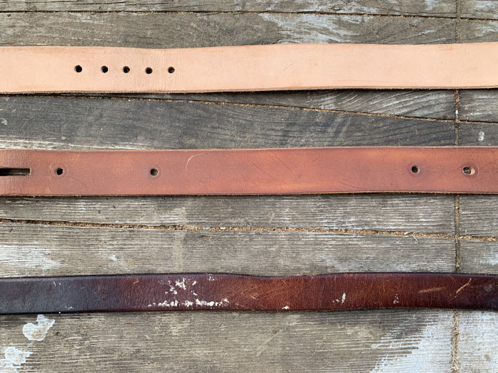 Three different strips of belt placed on the table.