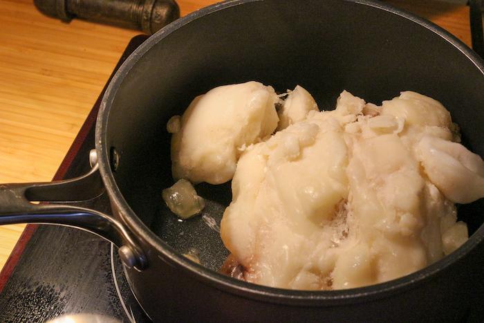 Suet being rendered in pan.